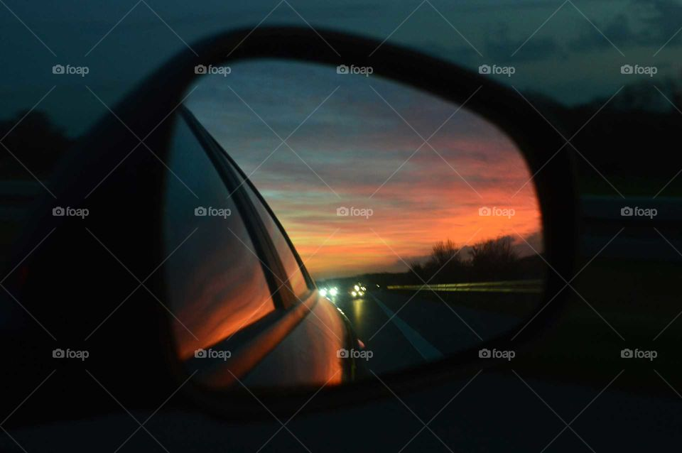 Mirrored image of amazing sunset at the travel