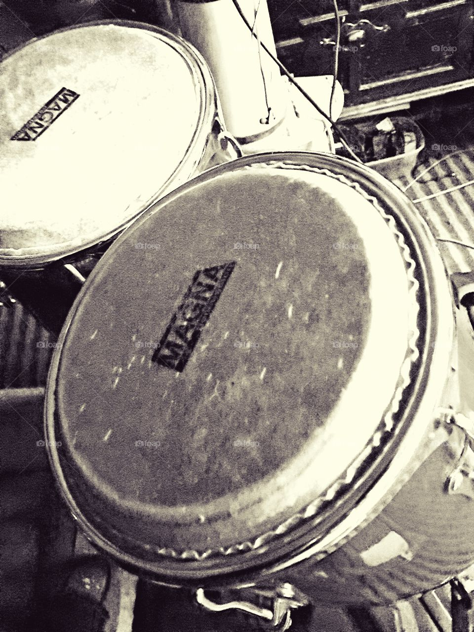 Black and white photo of a set of Magna bongo drums.