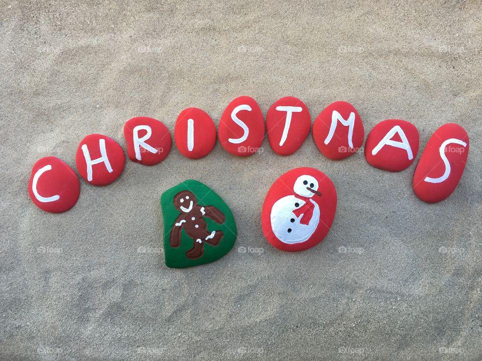 Christmas symbols on painted stones