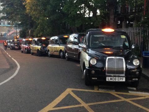 Queue of black London taxi cabs