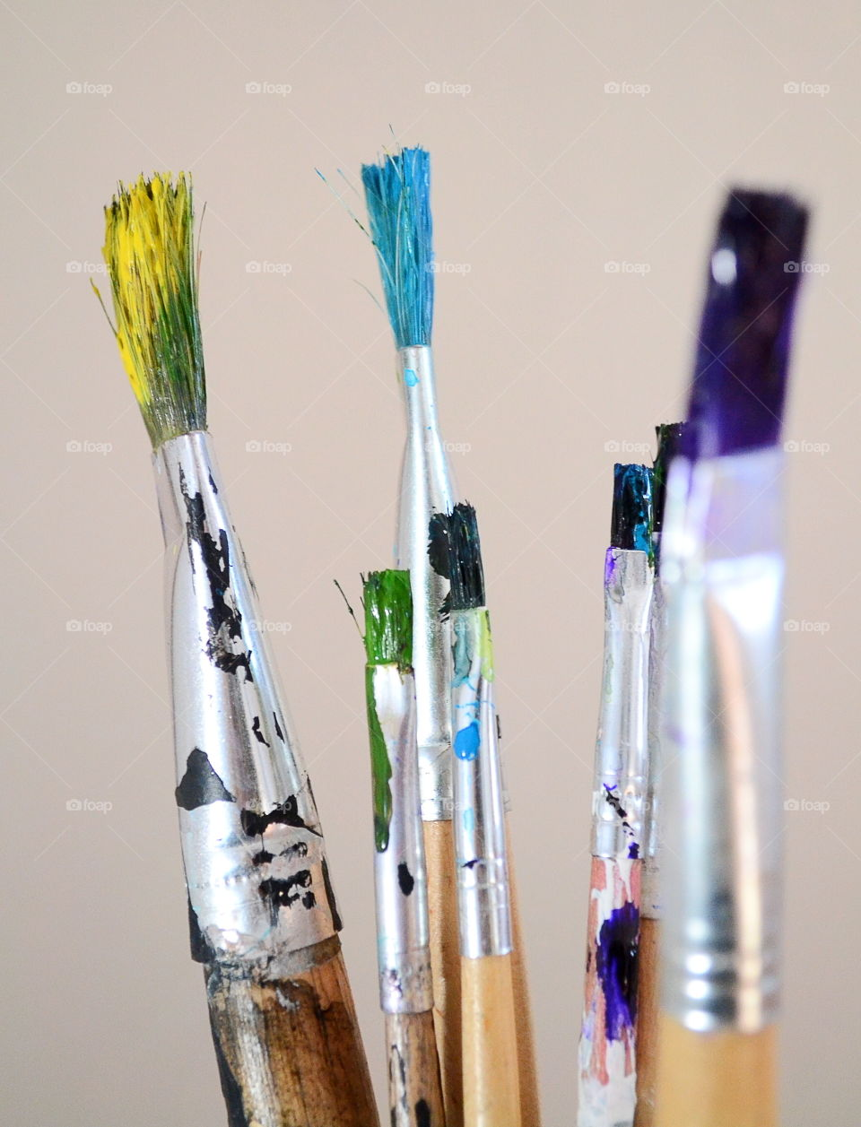 Paintbrushes against grey backgrounds