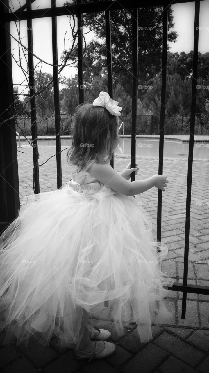 Flower girl. Wishing she could trade the dress for a swimsuit...