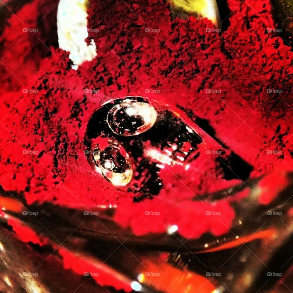 Red and Buried. A super macro photo I took of a bead and a red earthy powdery substance.