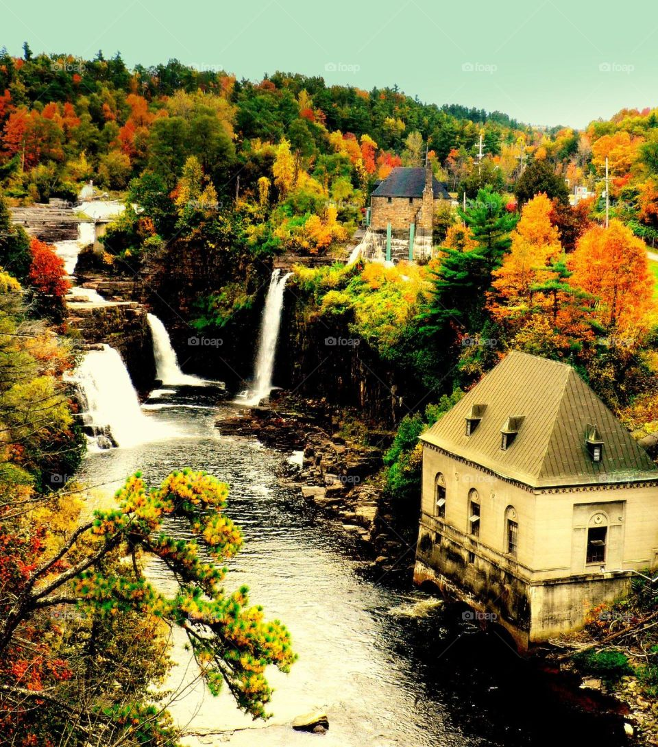 Ausable chasm. Waterfall and cottage along Ausable Chasm at Ausable River