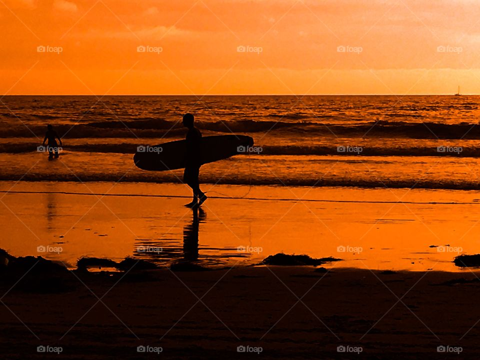 Surfer silhouettes