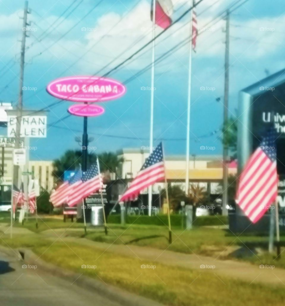 Memorial Day Flags along the Freeway lines I-10 from University of Phoenix then captures Taco Cabana and Ethan Allen in the background!