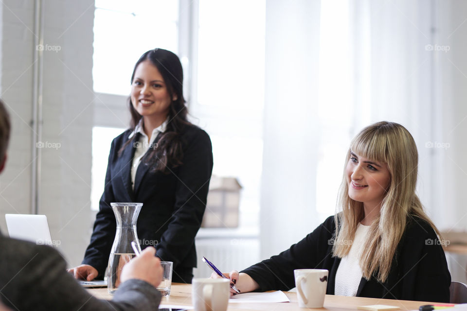 Smiling businesspeople in meeting