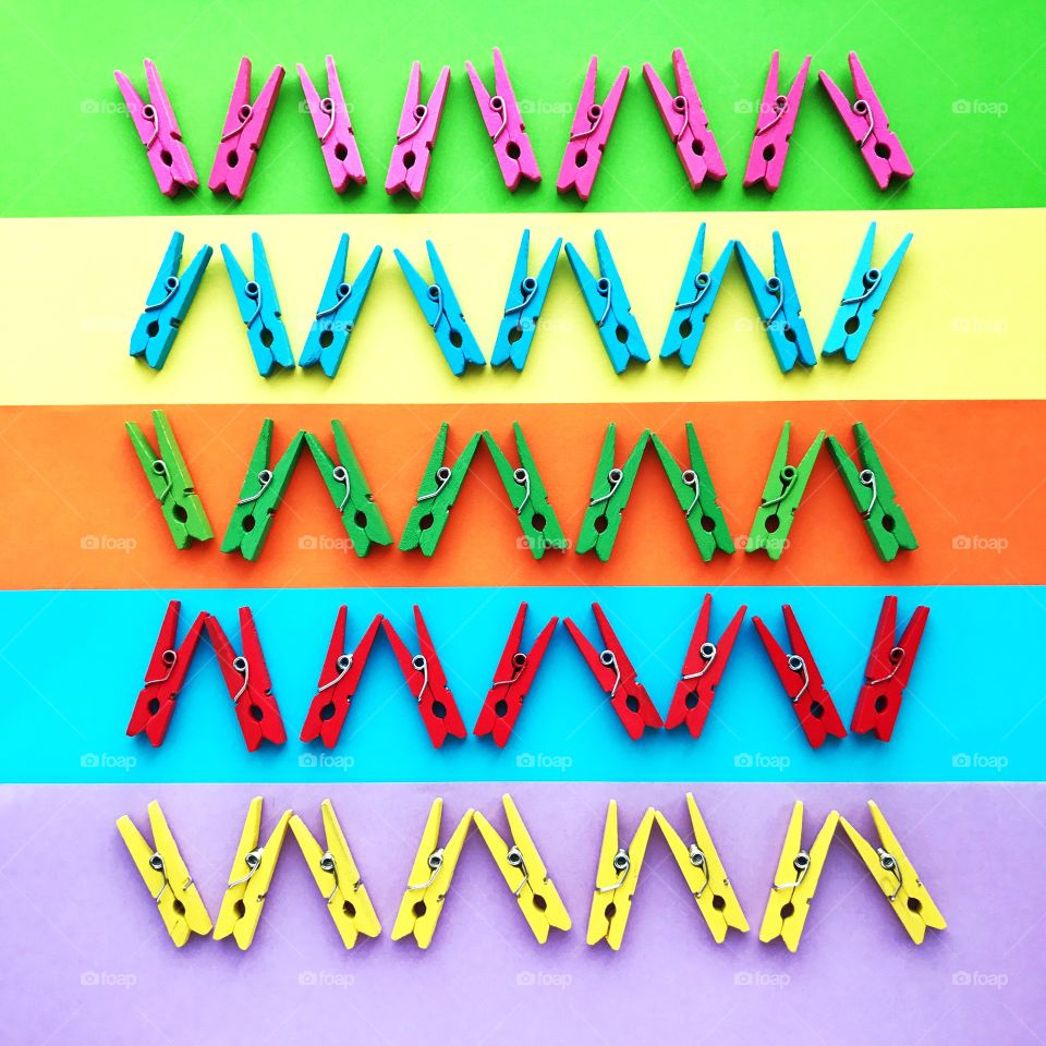 Colorful pins on colored background