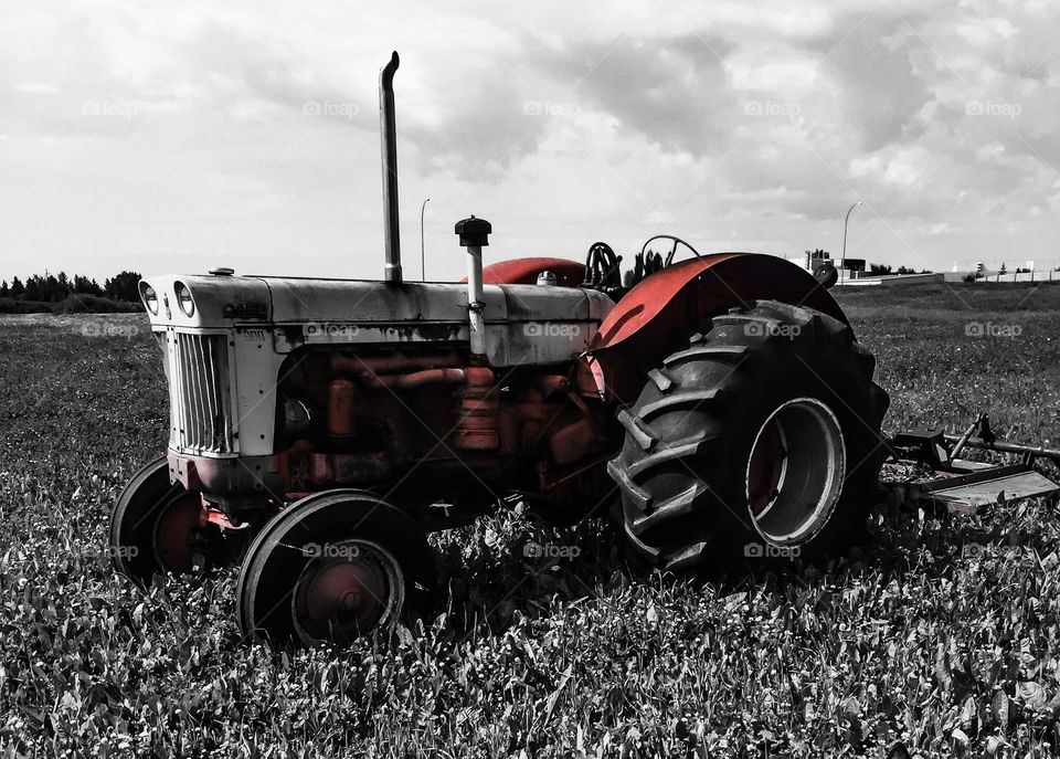 Stationary tractor in field