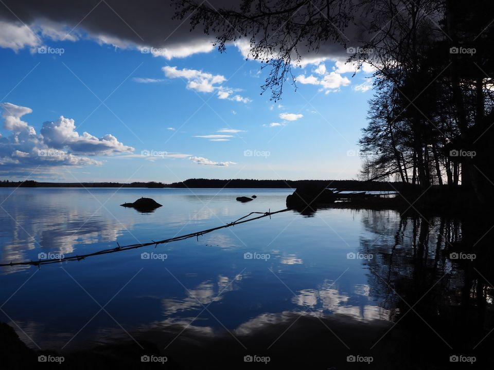 Beautiful white and blue landscape from Finland. Barbed wire goes through a stunning view.