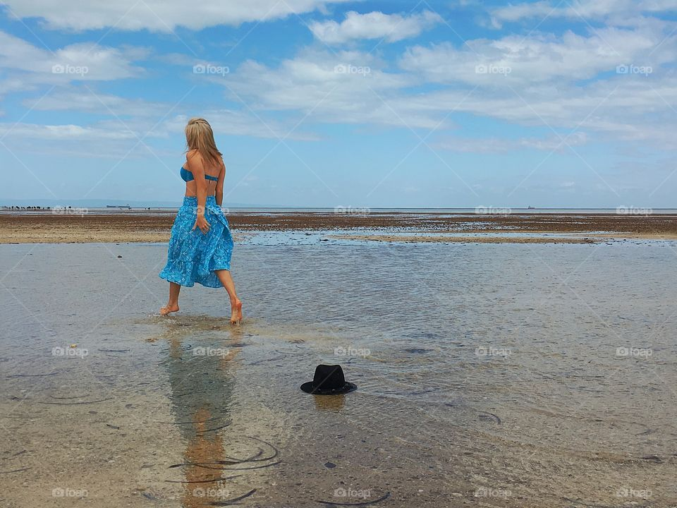 Rear view of woman walking on the beach
