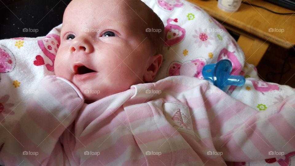Happy Newborn. Newborn baby wakes upand sees daddy...