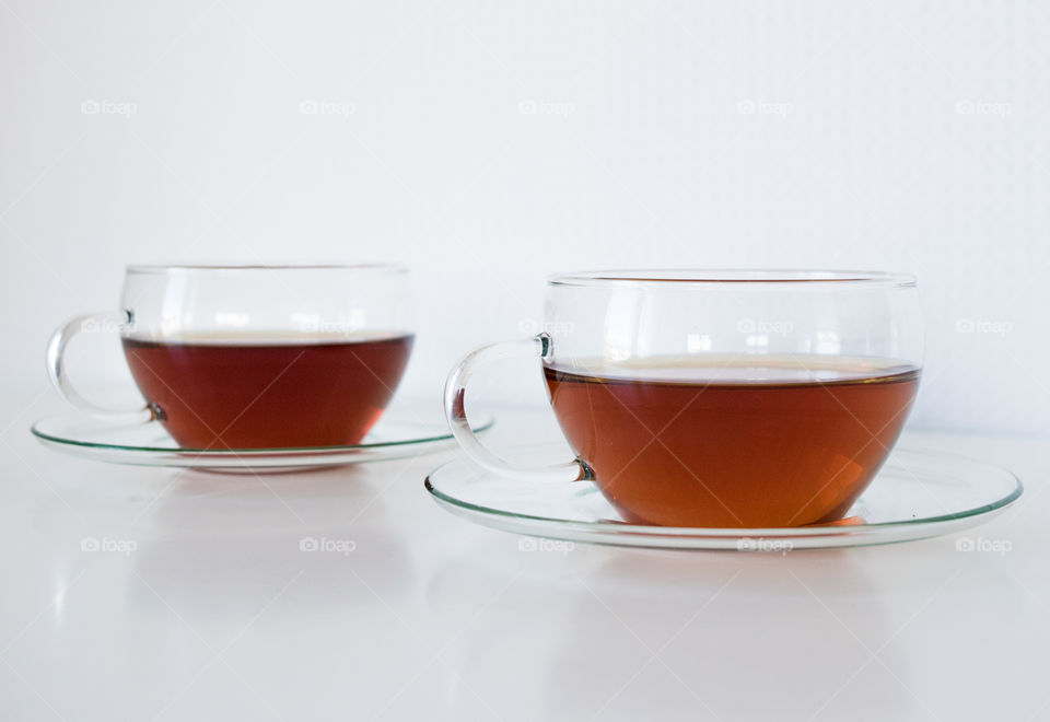 Two cup of tea on white background