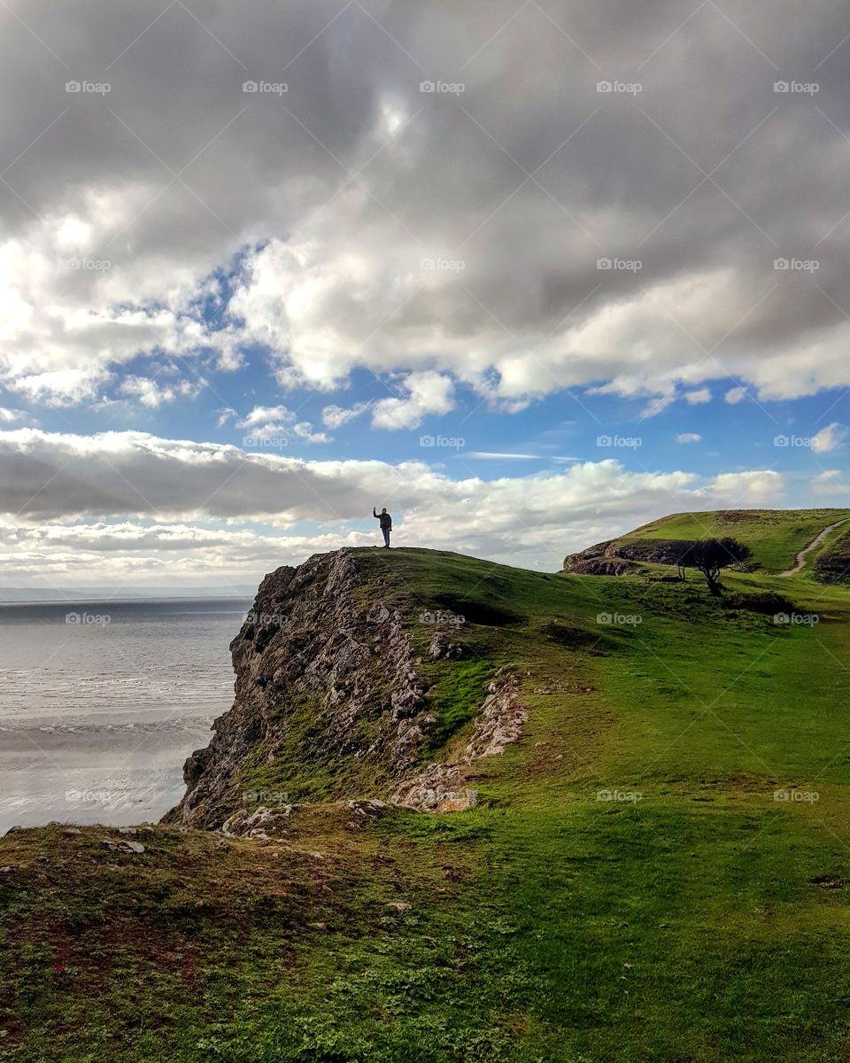 standing at the edge of the cliff Brean Down Somerset
