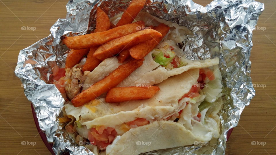 Chicken tacos with sriracha fries.