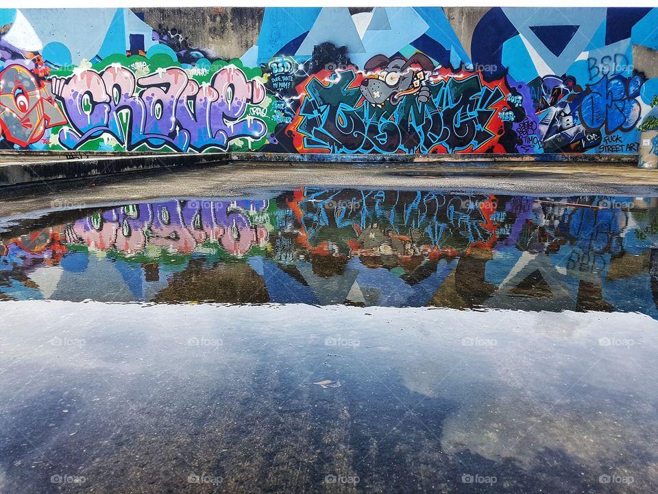 urban playground, colorful vivid street art graffiti reflection