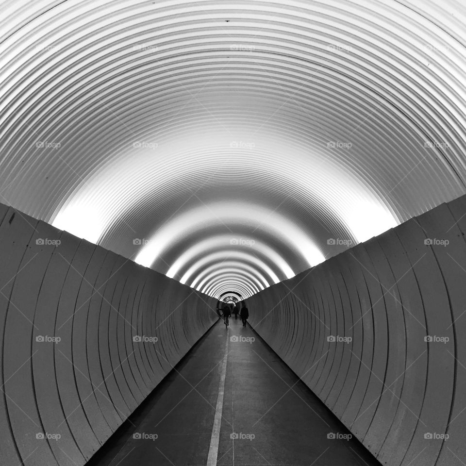 Silhouette of people in tunnel