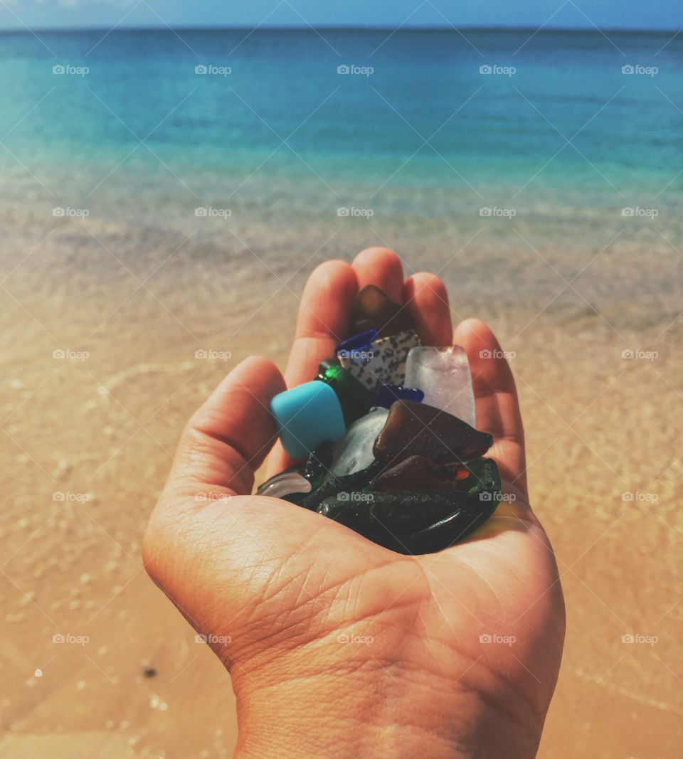 Hand Holding Sea Glass In Front Of The Ocean, Colorful Sea Glass, Summertime By The Sea, Outstretched Hand Holding Sea Glass, Sea Glass, Colorful Beach Scene