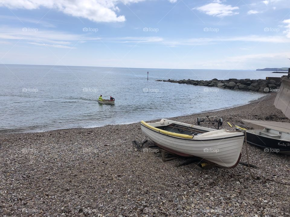 Even more sunshine and a chance to capture a little boat reaching the shoreline in Sidmouth, UK today.