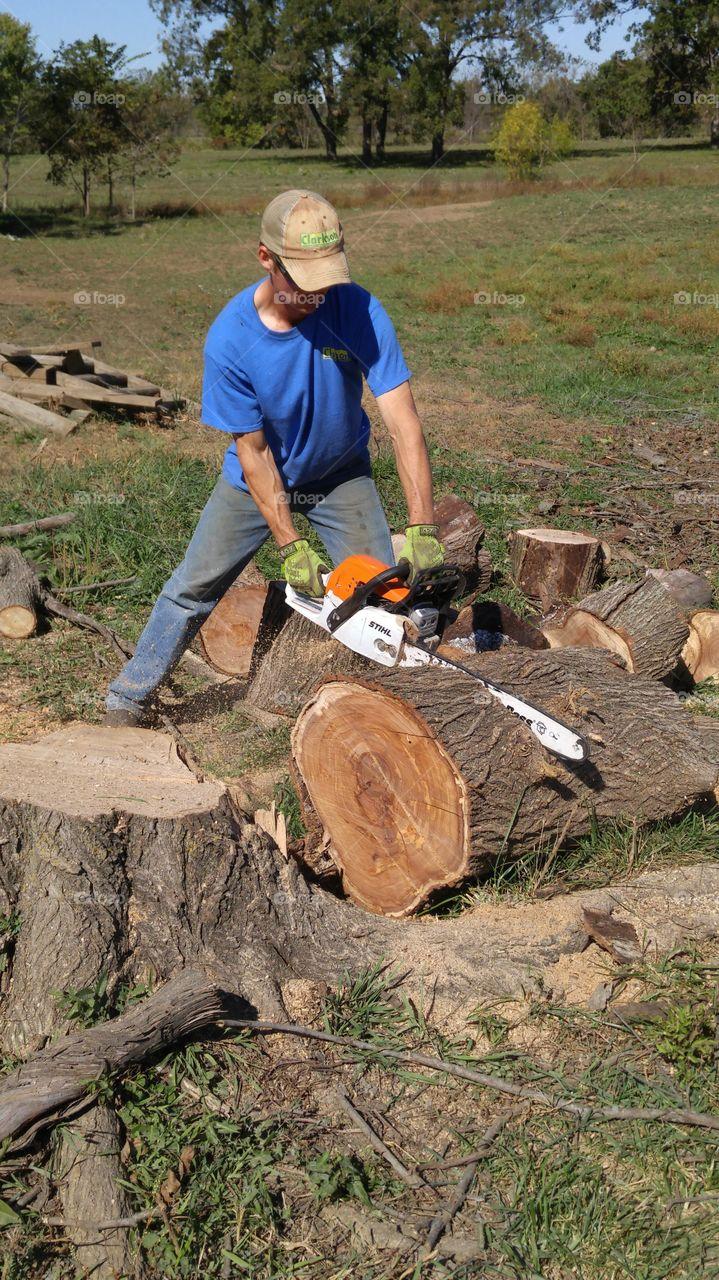 using a stihl chainsaw to cut wood