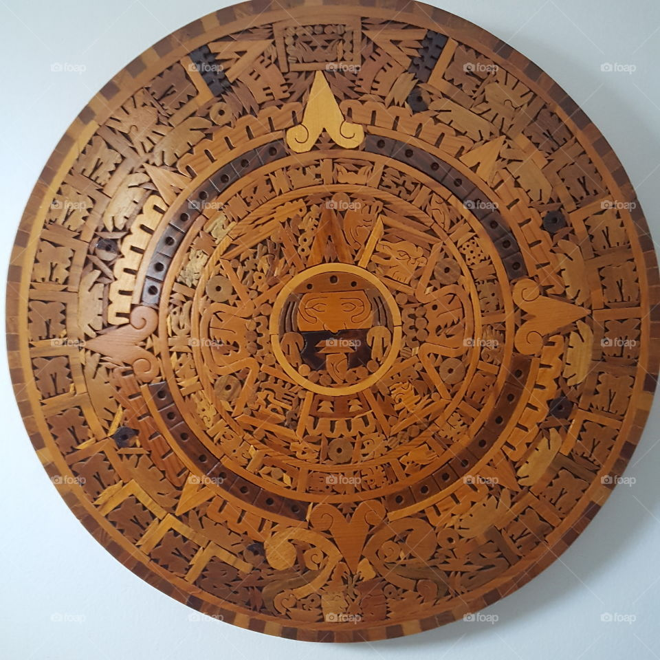 This one is a native American  piece made of wood and handcrafted it's beautiful.