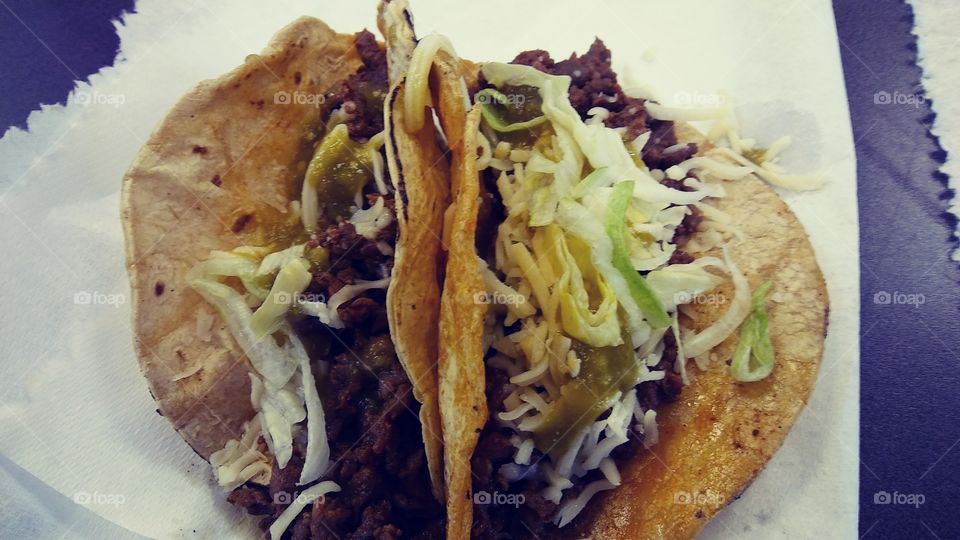 Carne Asada tacos that I was fortunate to nosh on at work when a supervisor brought all the fixins to grill and prepare for all of us for a tasty lunch on a Saturday.  We work at a call center so Saturdays are normal work days for us but tacos are not so it was a real treat.