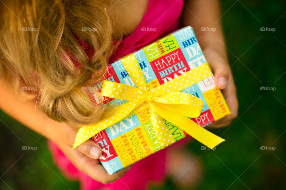 Little girl with present box . Happy birthday