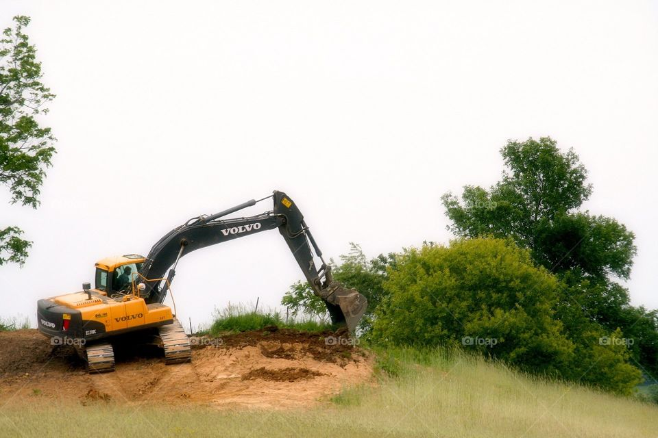 Digging a Ditch.  Volvo heavy equipment in action.