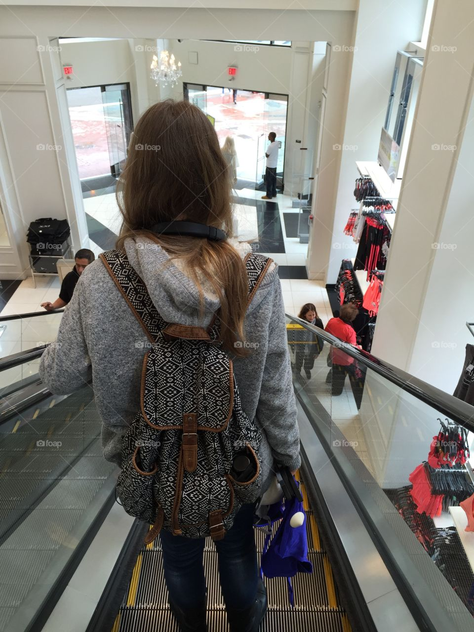 Teen girl is at the clothing store