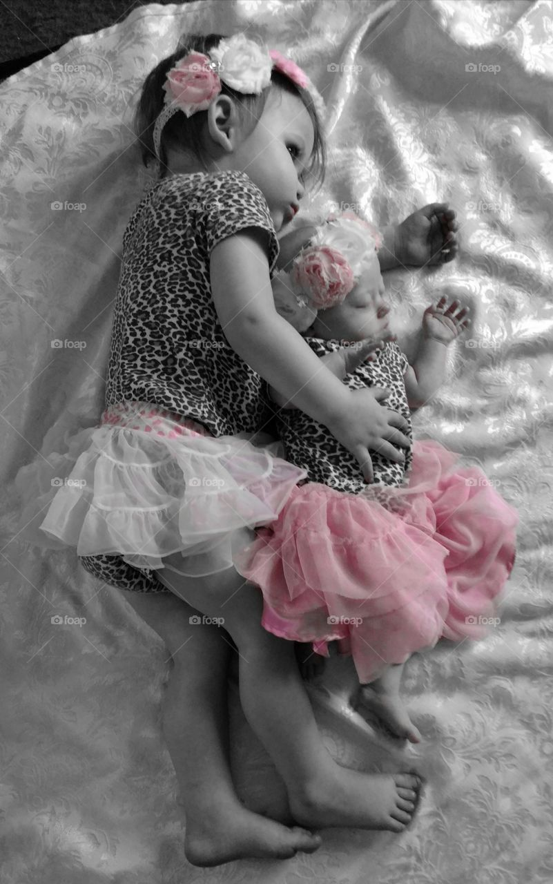 Two cute baby sleeping on bed