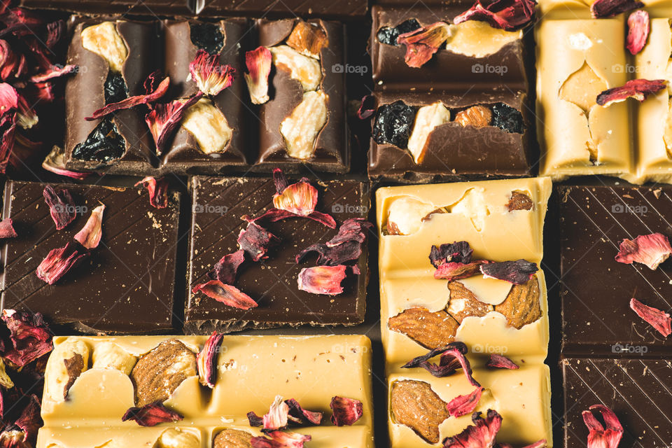 Different kinds of chocolate with rose petals