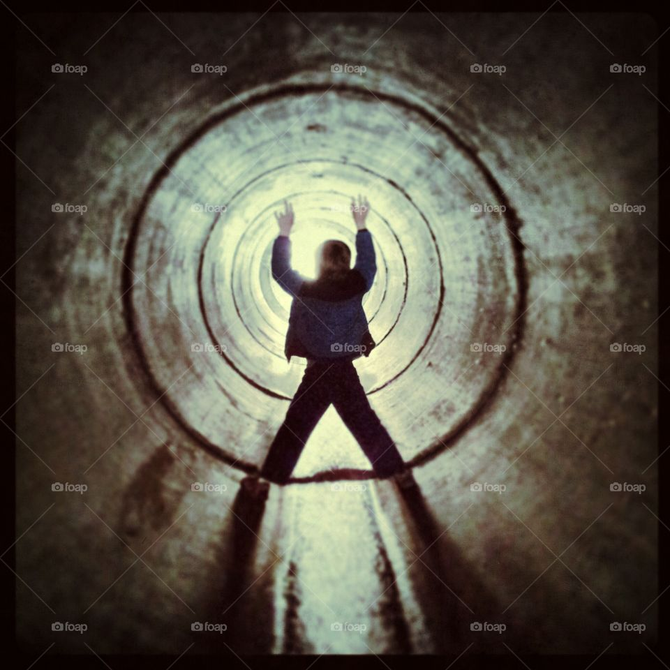 Boy in tunnel