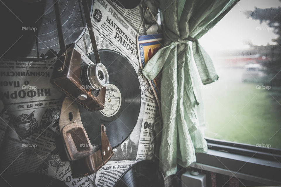 Old vinyls, newspapers and camera on the wall