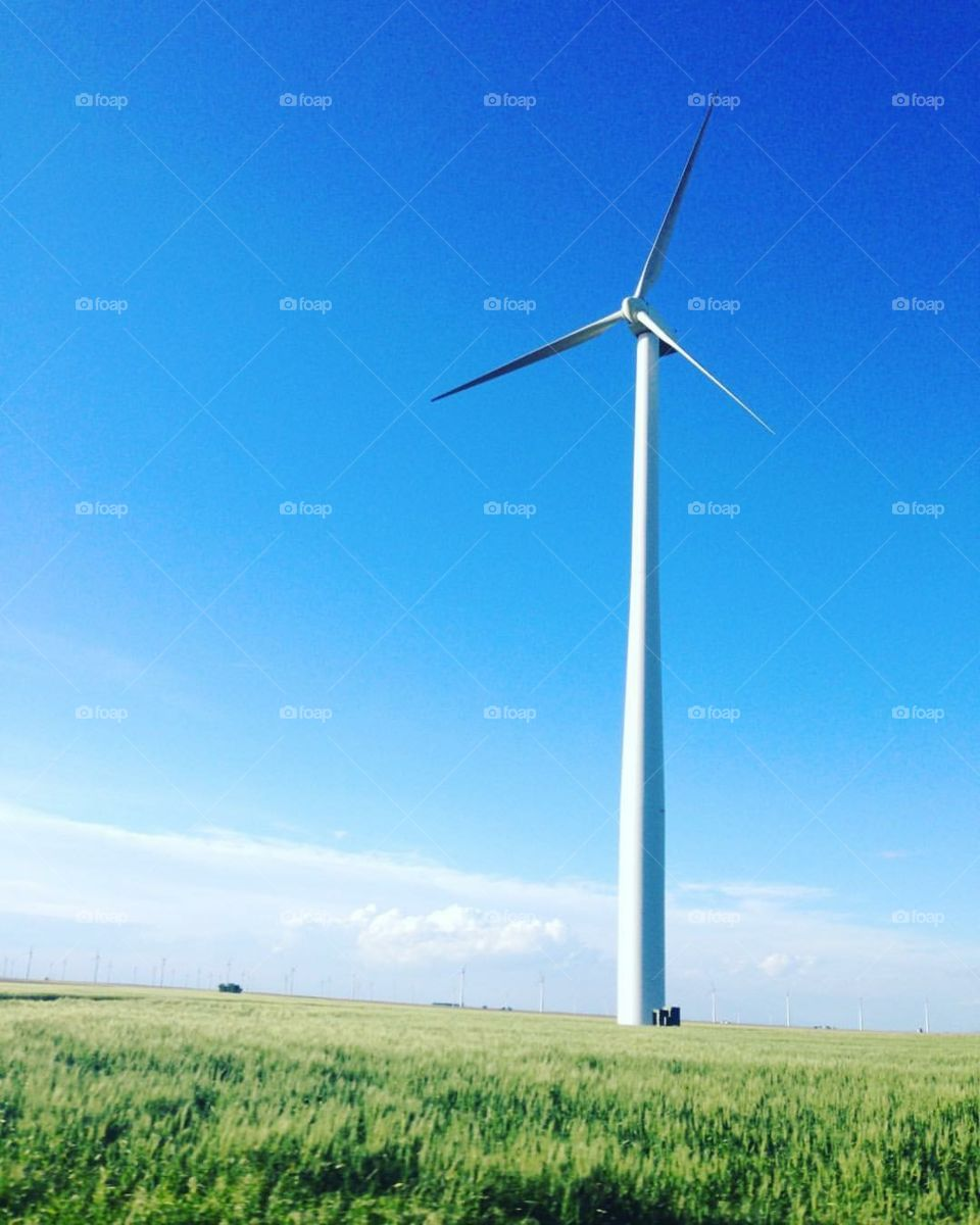 Windmill with bright blue sky