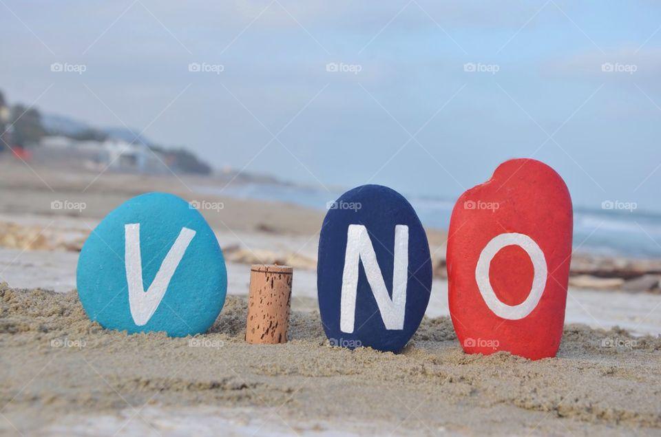 Vino, italian wine word on stones