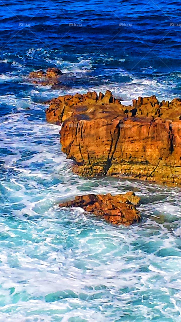High Tide @ Red Rock Cliff. High tide at rock cliff in Hiesler Park in Laguna Beach