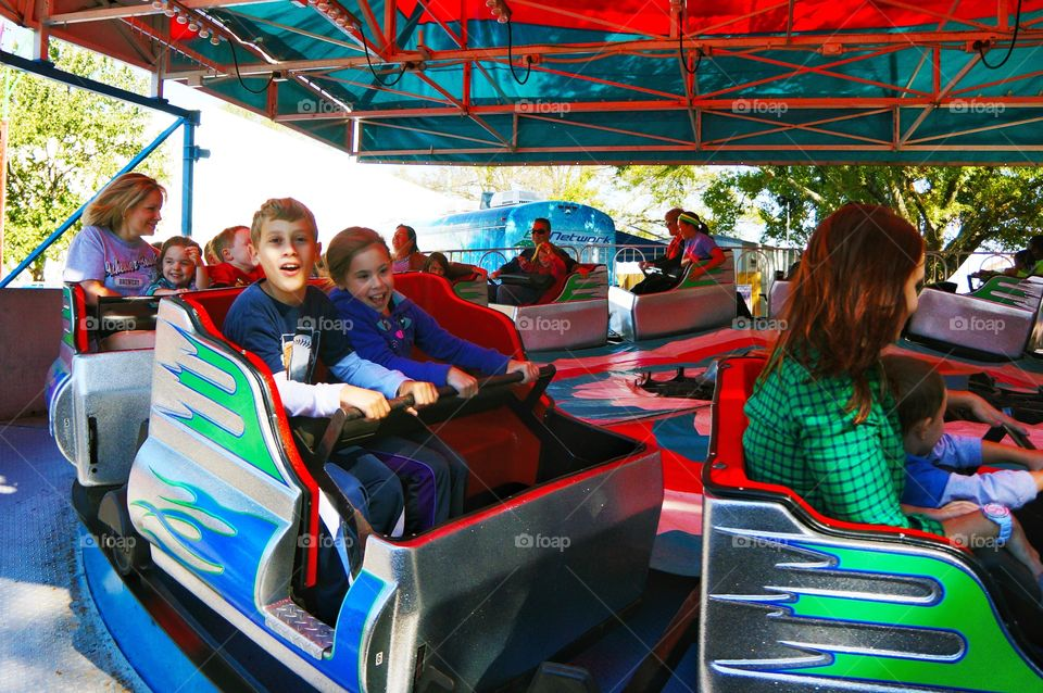 People ride at amusement park