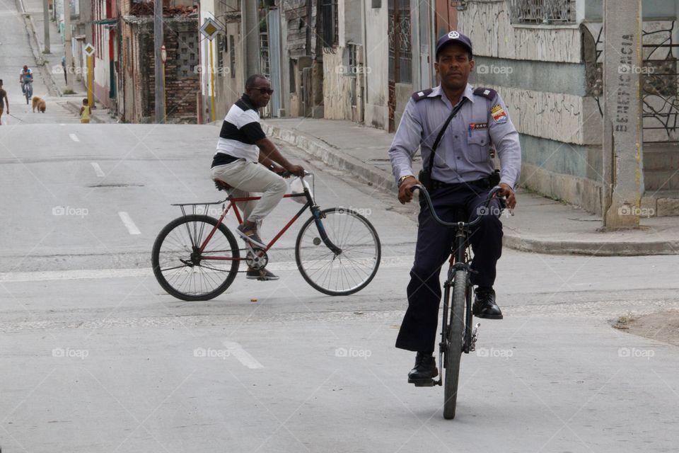Cuban People.Police officer on bike.