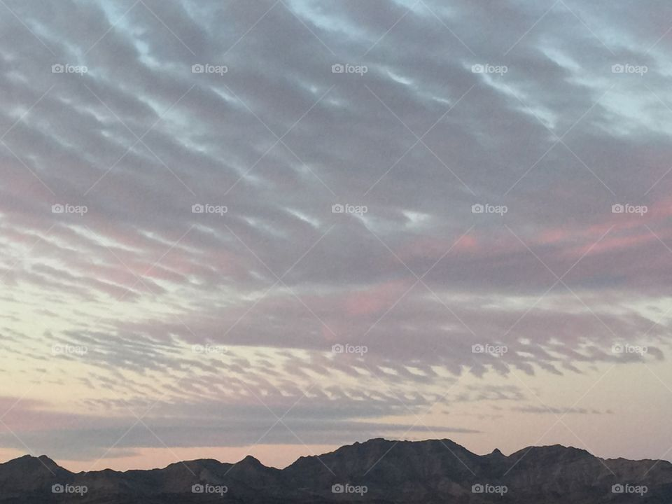 Beautiful cloud pattern shown with the warm colors of the setting sun.
