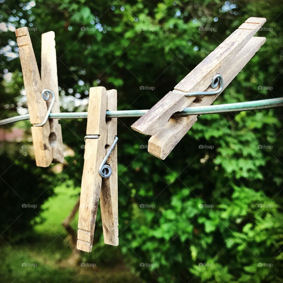 Wooden clothes peg on clothes line