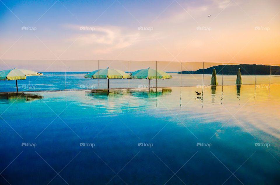 Beach umbrella in swimming pool