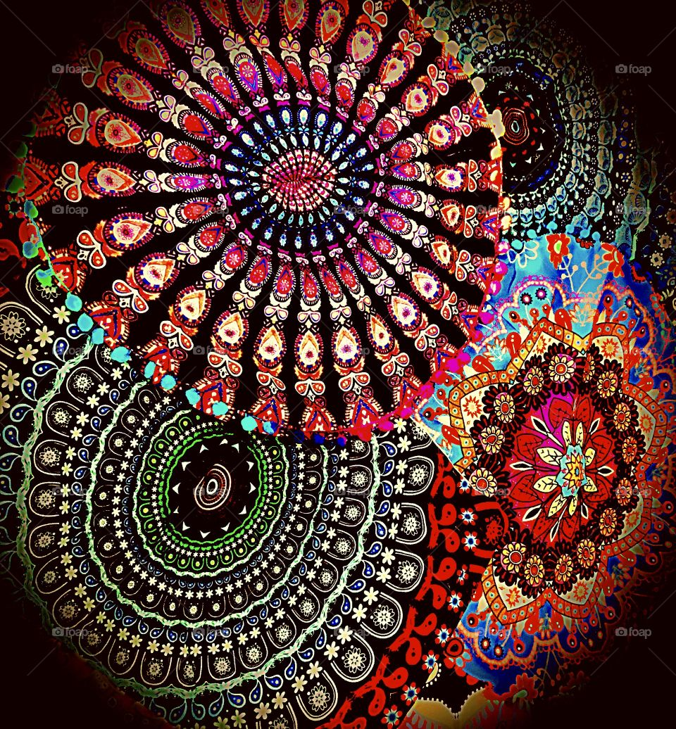 Bohemian textiles laid out- funky and bold. Beautiful colour.
