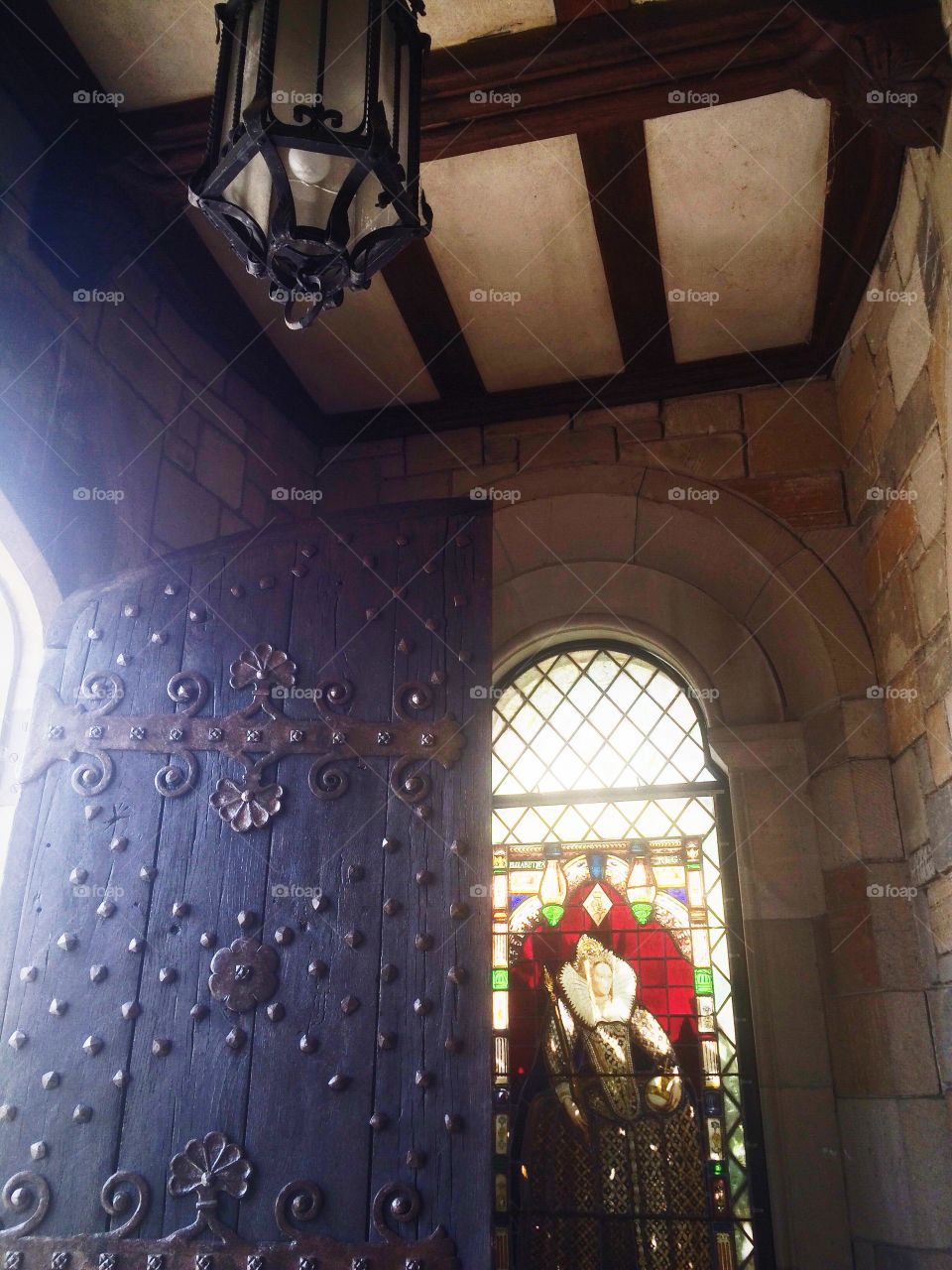 Castle Entry. Stained glass and an ornate door