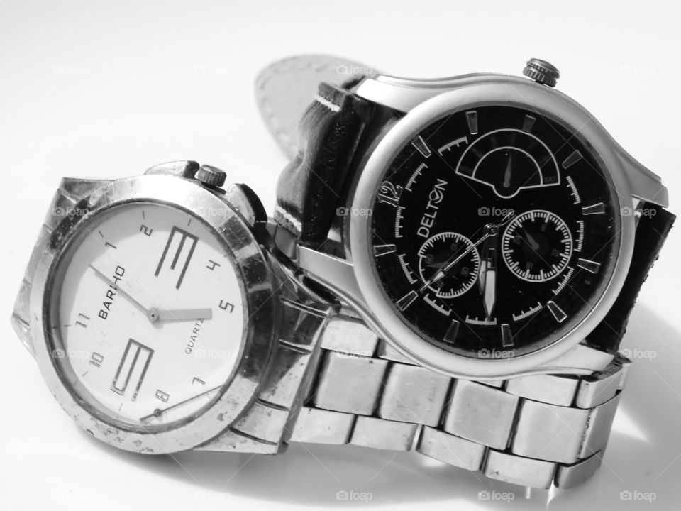 Watch for men - My favorite gadget. Two analog wrist watches arranged with black and white dial and steel belt.