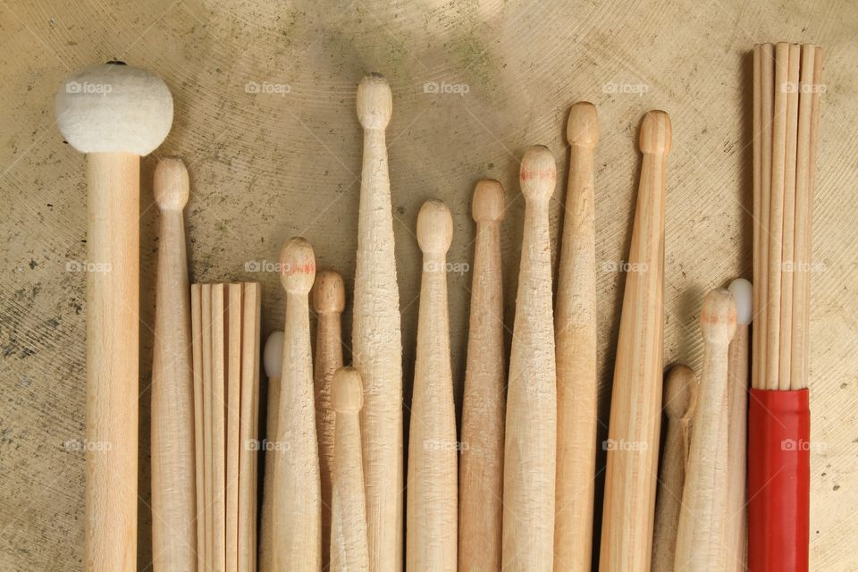 Various drumsticks on a cymbal