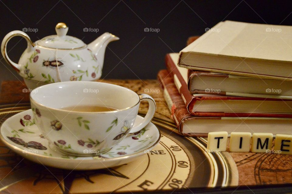 Tea with stack of books