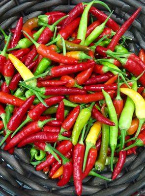 Green and red chillies in basket