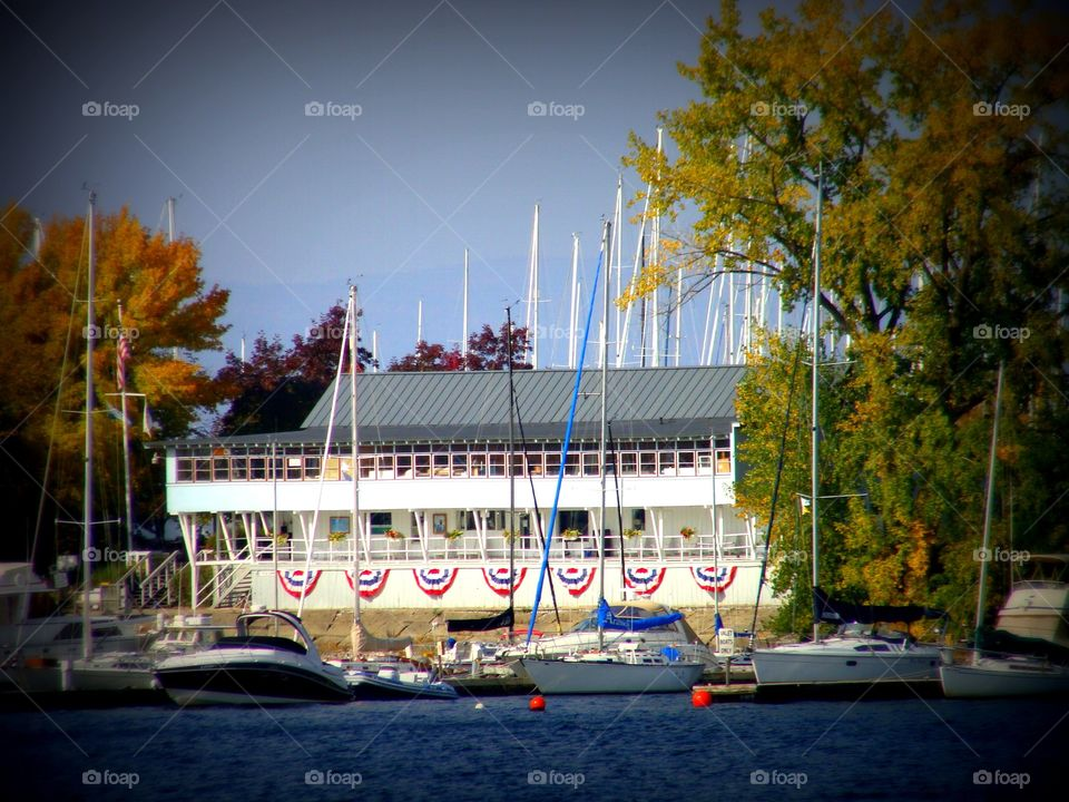 A patriotic marina with a host of boats sits on the shores of Lake Champlain in Burlington, Vermont.