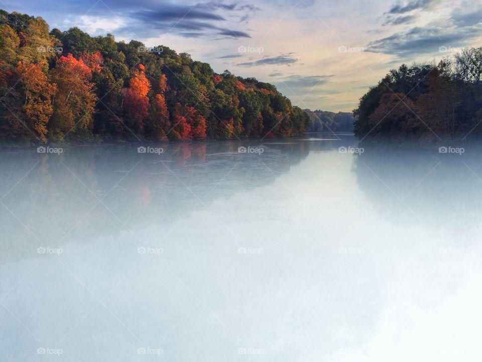 Autumn trees reflection on lake
