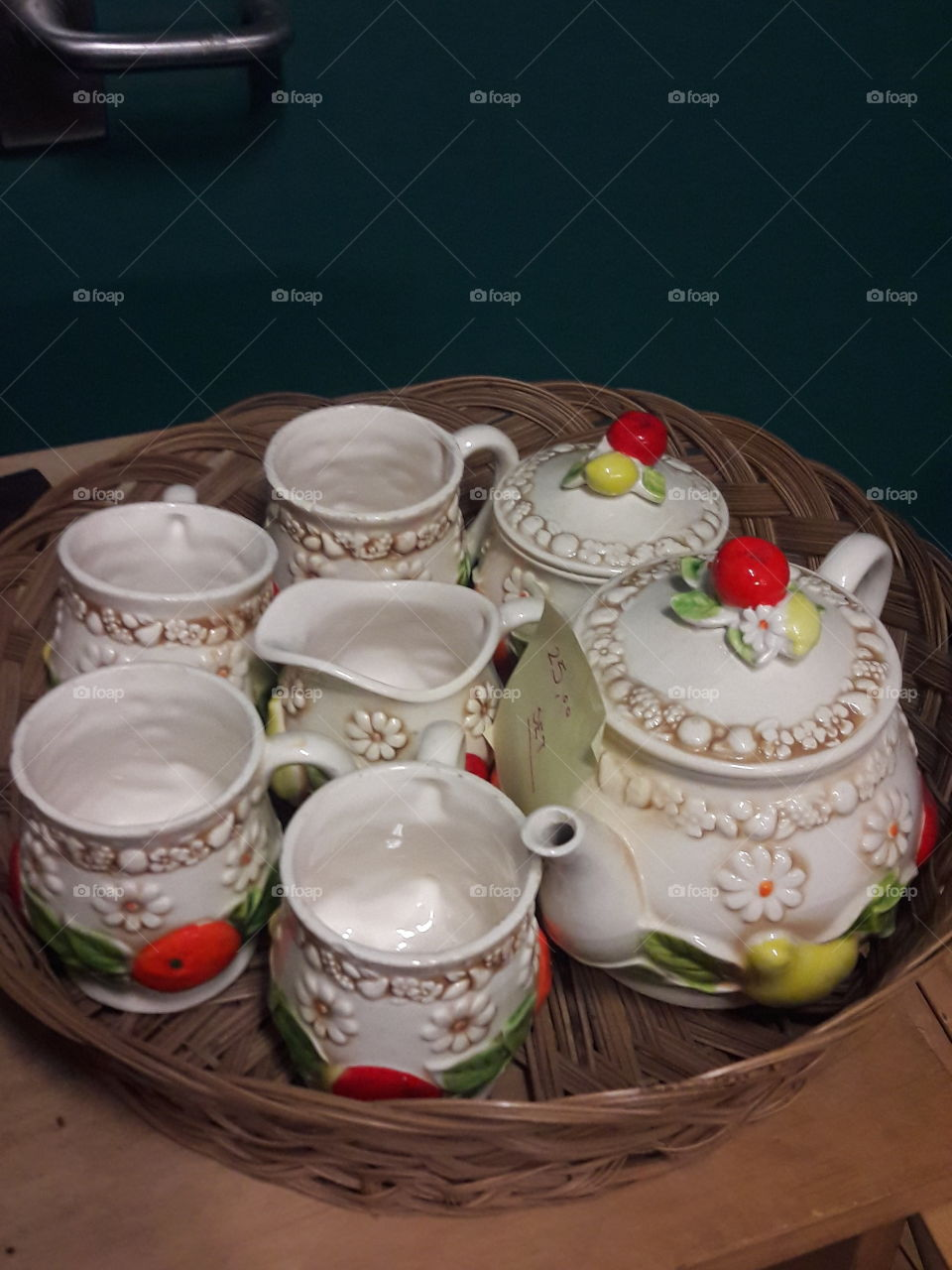 a tea set in a thrift store waiting to be bought.